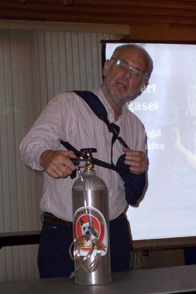 Dr Philip Nitschke with a 'Max Dog Brewing' nitrogen canister