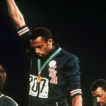 Peter Norman stands beside Tommie Smith and John Carlos, at the 1968 Mexico City Games.