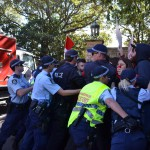 Police clash with protesters at Carillon Avenue