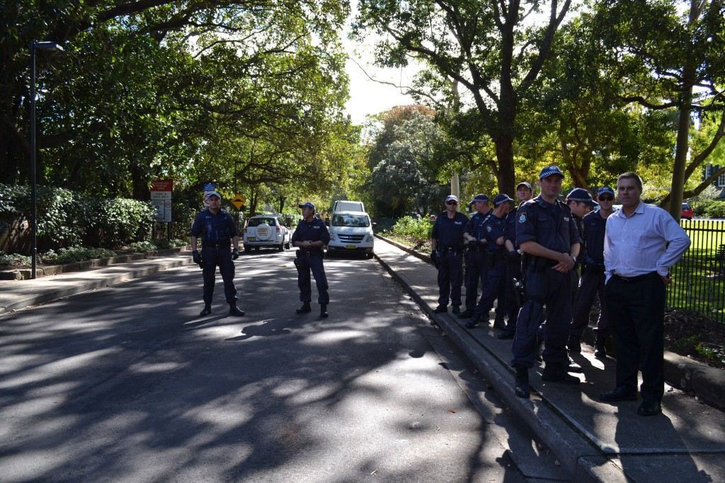 Police with a member of Campus Security on May 14 at the Carillon Avenue entrance