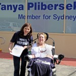 Loredana Mulhall (right), with a petition outside Tanya Plibersek's office on Broadway