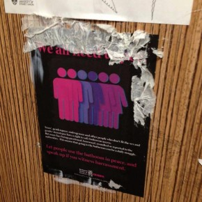 A sticker that was defaced in a women's bathroom on campus
