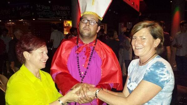 Christine Forster and her partner are 'married' by 'Cardinal Pell' (Source: Twitter @resourcefultype)