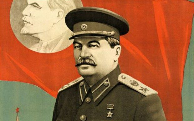 Propaganda image of Stalin in front of flag of Lenin.
