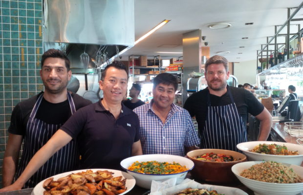 Hieu Luong (second from right), with the staff of  Taste Baguette Usyd