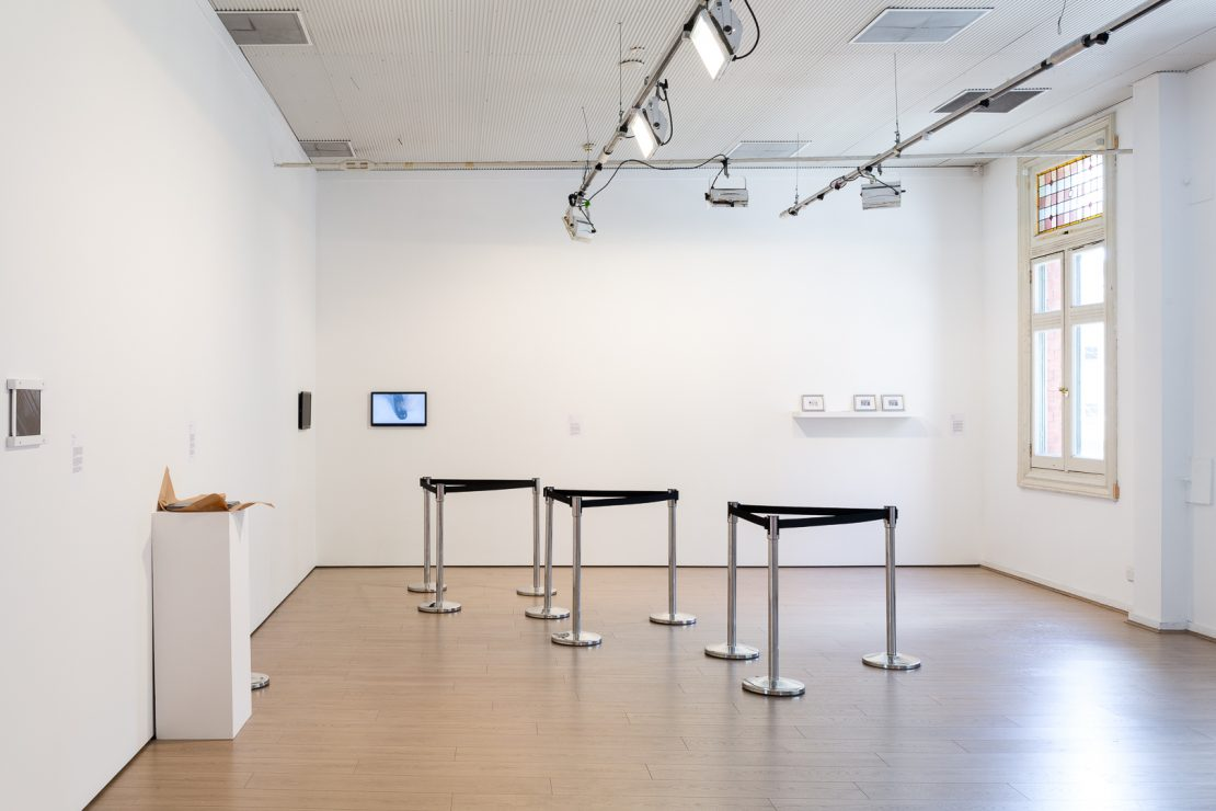 Barrier setup that recreate a sense of government restriction. image credit: Art Guide