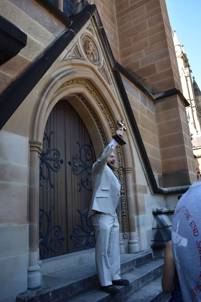 "A member of the Catholic Church's congregation stood in front of the Cathedral chanting ""Deus Vult""."