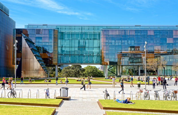 people walking past Sydney Law School