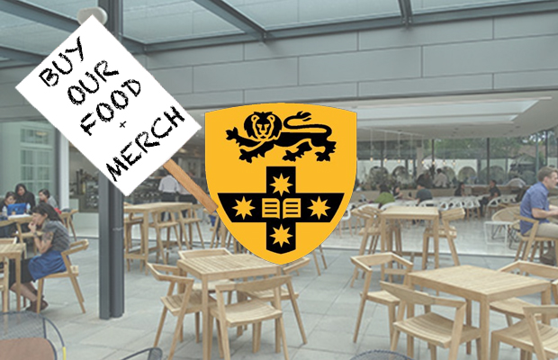 "Faded photograph of the USU's Courtyard Cafe with the yellow USU logo on top. The USU logo features a back lion, which has been photoshopped here to look like he is holding a protest sign. The sign reads ""Buy our food + merch""."