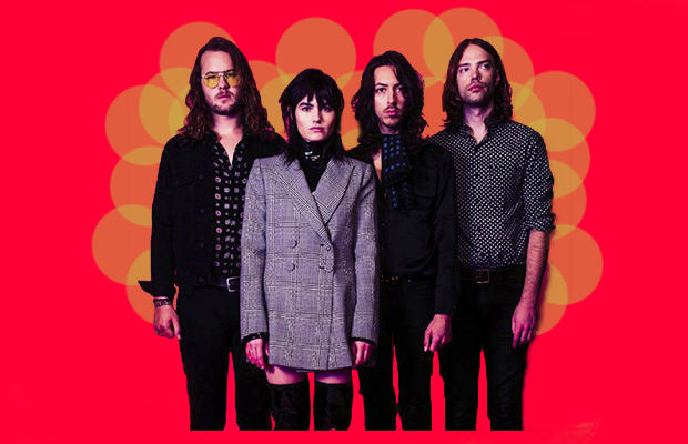 Photograph of The Preatures with a red-pink background and 70's style opaque yellow circles printed behind their heads.