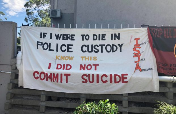 A sign put up by protestors along Waterloo Green: 'If I were to die in police custody know this... I did not commit suicide.' Photo credit: Red Flag Newspaper.