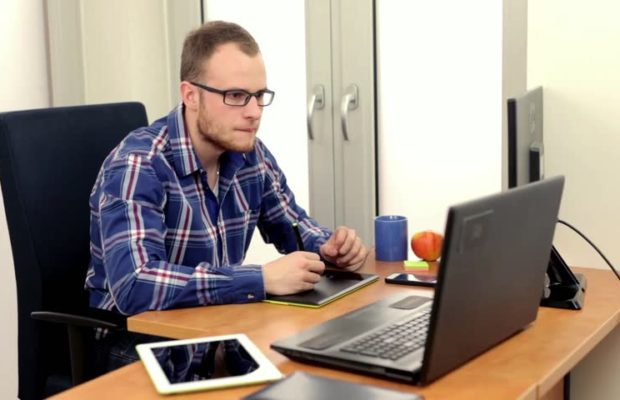 Image: stock photo of a plain white man sitting at a laptop looking agitated. Source: Shutterstock.
