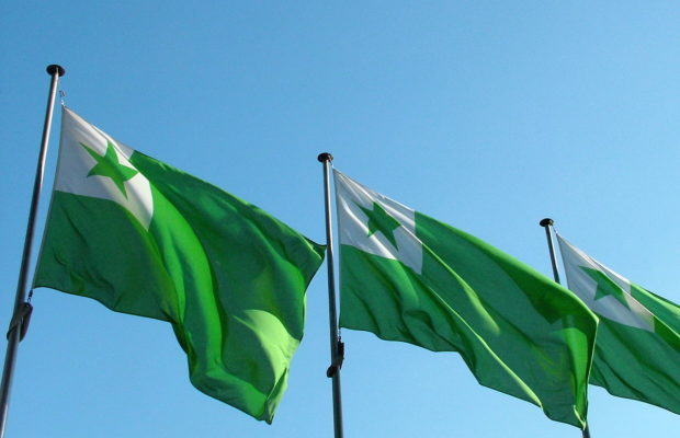 Three green flags, each with a green star in the top left corner against a white square.