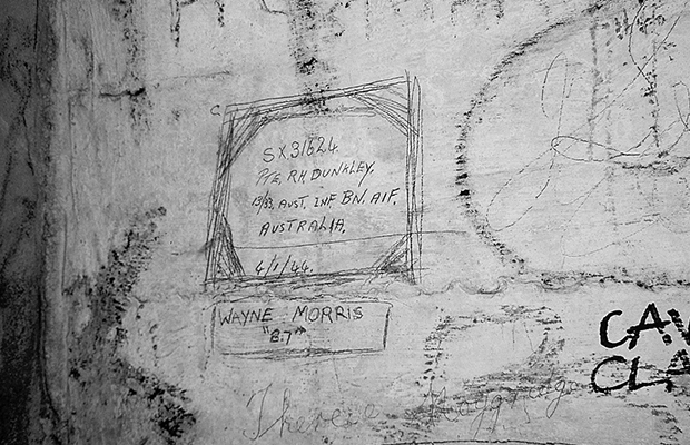 Soldiers' graffiti, with some Cave Clan graffiti at the bottom right. Photo courtesy of John Oakes, Australian Railway Historical Society.