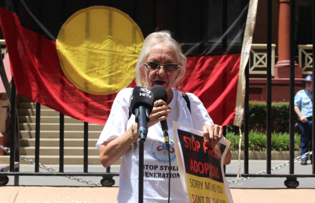 Hazel Collins speaks to the rally in front of NSW Parliament.