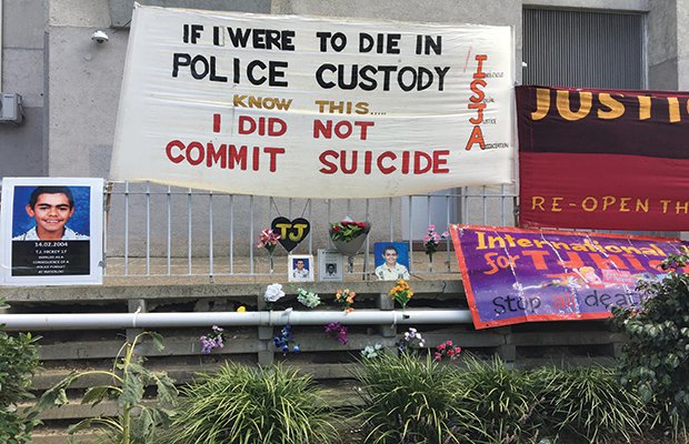"Memorial set-up for TJ Hickey on the fence where he passed away, banner reads ""IF I WERE TO DIE IN POLICE CUSTODY, KNOW THIS, I DID NOT COMMIT SUICIDE"""