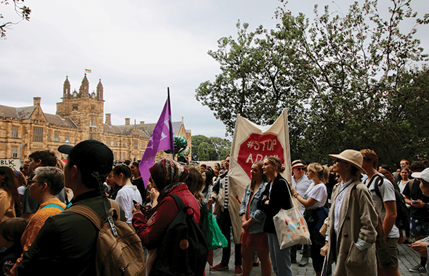 USyd students begin to exit university grounds outside of Fisher Library. Photo by Amelia Mertha.