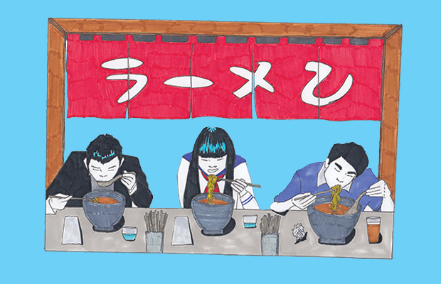 Three people eating at a ramen shop