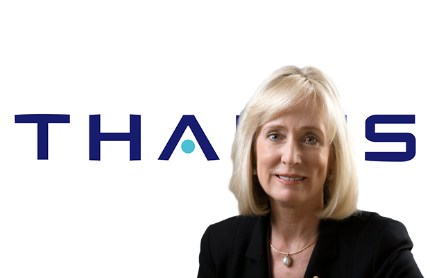 A head shot of Belinda Hutchinson superimposed over the Thales logo on a white background