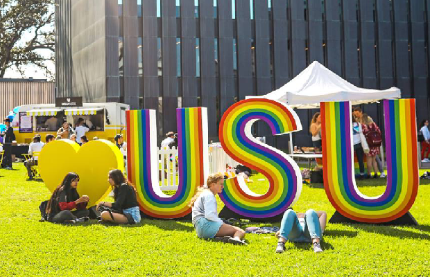 "A photo of large letters spelling ""USU"" on the Law Lawns at Sydney Uni."