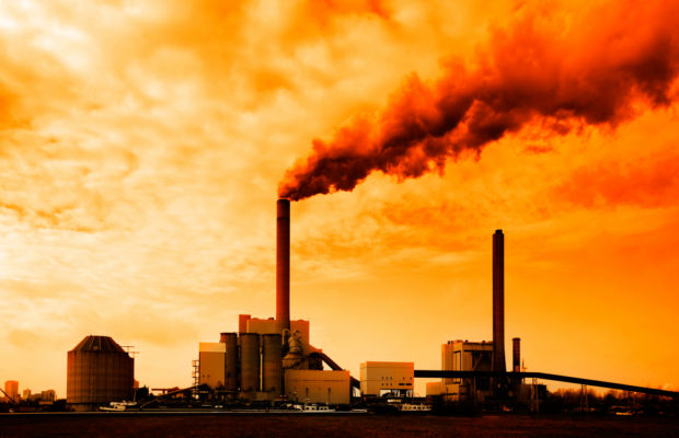 Fossil fuel industry emitting smoke