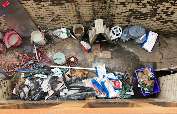 An overhead image of construction tools outside the lower ground female toilets in the Quad.