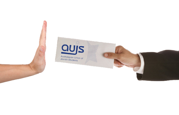 A hand turning down a ticket with the logo for AUJS on it.