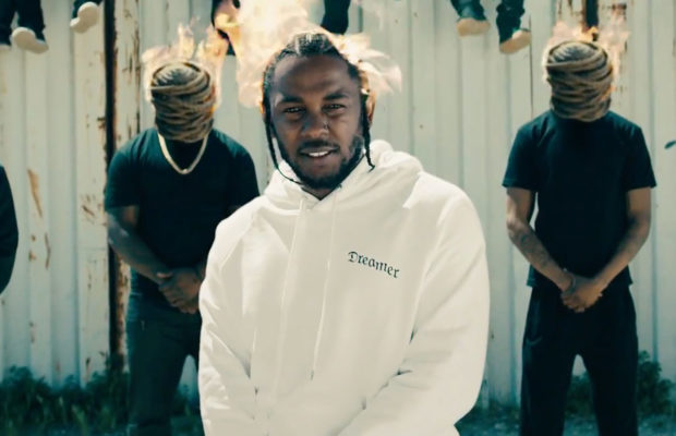 Kendrick Lamar surrounded by men who are all burning