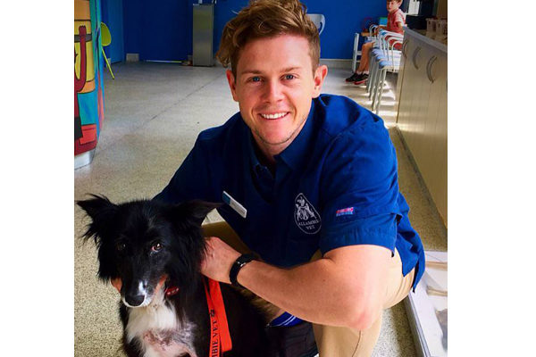 A photo of James Crowley with a dog