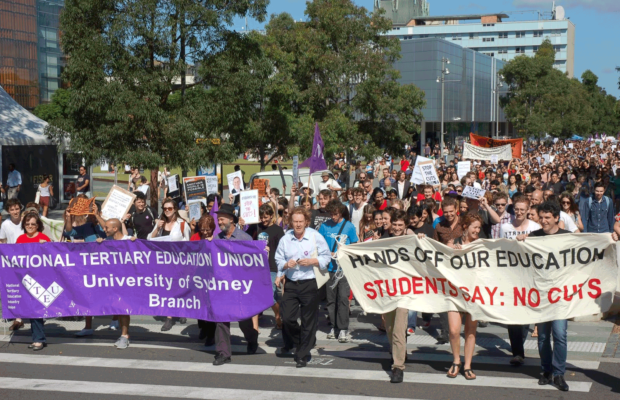 students and staff marching