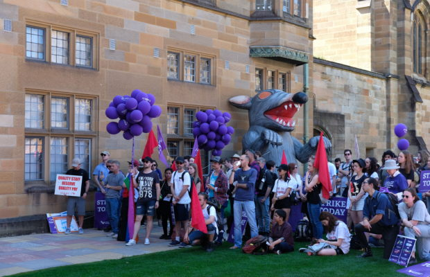 The strikers and 'Scabby the Rat' in the Quad. Image: Nick Bonyhady