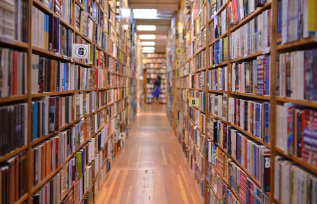 picture of aisle at bookshop with bookshelves on either side