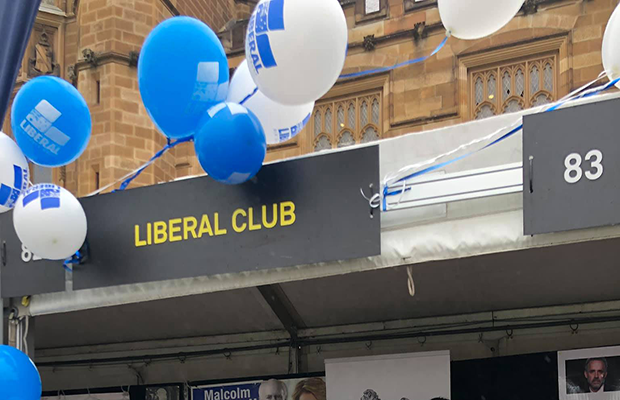 "Image of SULC stall signpost which reads ""Liberal Club"" surrounded by blue and white balloons"