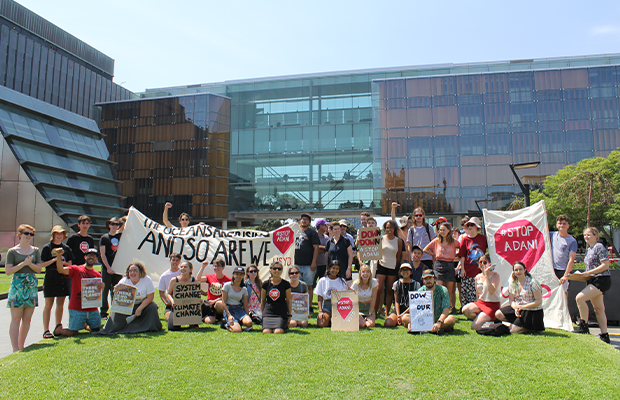 Activists pose at the Stop Adani speakout on Tuesday: Photography by Vinil Kumar
