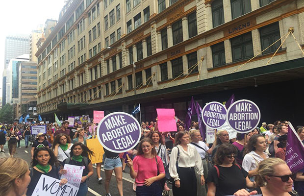 The IWD 2019 march makes its way through Sydney's CBD.