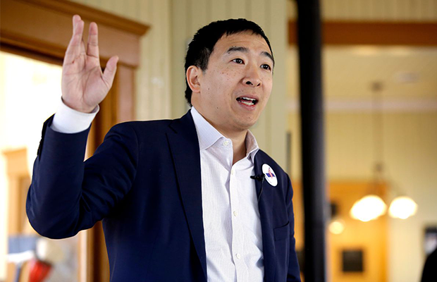 A photograph of Andrew Yang giving a speech