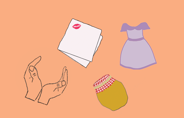 A napkin with a kiss on it, a purple dress, a jar of honey, and a pair of hands are scattered on a peach-coloured background.