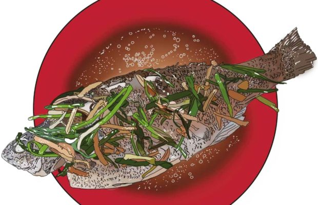 Steamed fish on a red plate
