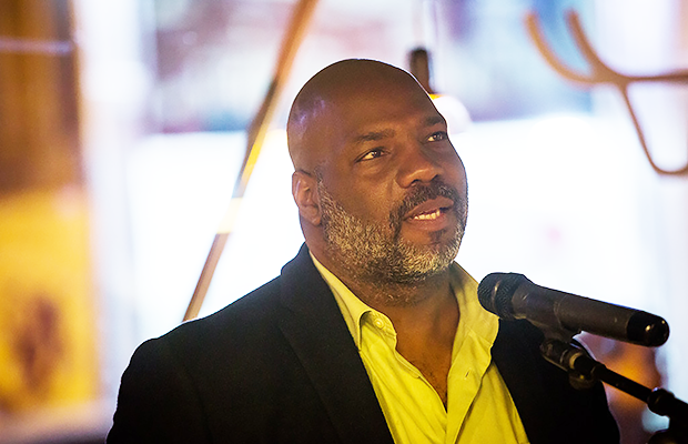 Photograph of Jelani Cobb in a white suit shirt and navy jacket