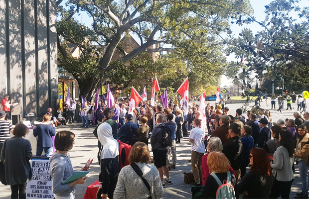 Photo taken from outside Fisher library of a crowd of students at the rally.