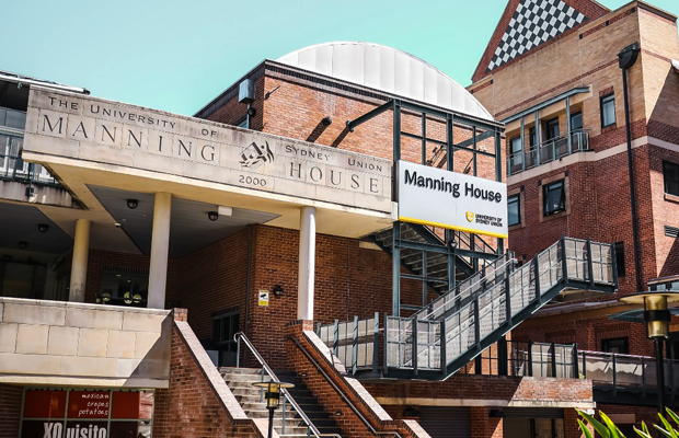A photo of the front of Manning Building at the University of Sydney on a sunny day