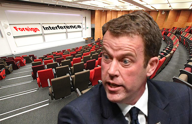 """Photo of Dan Tehan in a lecture class where whiteboard reads """"foreign interference"""""""