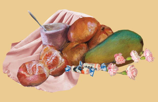 A mixed media artwork with mangoes, white rabbit lollies, pink cloth and flowers